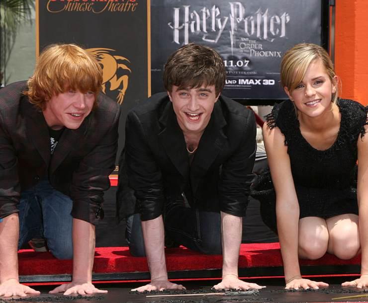 Da sinistra: Rupert Grint, Daniel Radcliffe ed Emma Watson in Harry Potter - Fonte: Getty Images